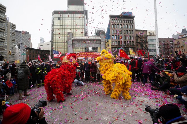 People take part in the 22nd New York City Lunar New Year celebration, the year of the Ox, amid the coronavirus disease (COVID-19) pandemic in the Chinatown area of the Manhattan borough of New York City, New York, U.S., February 12, 2021. (Photo by Carlo Allegri/Reuters)