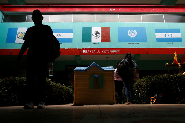 A man walks past pictures of Mexico's and other Central America countries' flags at Belen migrant shelter in Tapachula, Chiapas, Mexico November 16, 2016. (Photo by Carlos Jasso/Reuters)