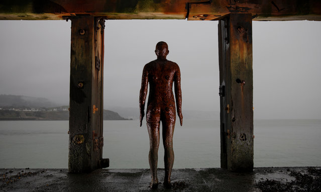 A sculpture by British artist Antony Gormley stands under the harbor wall on January 13, 2021 in Folkestone, United Kingdom. On Monday January 4th England entered its third lockdown due to the Coronavirus pandemic. Schools and colleges moved to online learning, mixing with people outside households and bubbles was curtailed and non-essential food shops closed. (Photo by Dan Kitwood/Getty Images)