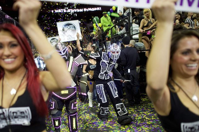 Cheerleaders and characters supporting contestants parade through the Wells Fargo Center before the 23rd annual Wing Bowl in Philadelphia, Pennsylvania January 30, 2015. (Photo by Mark Makela/Reuters)