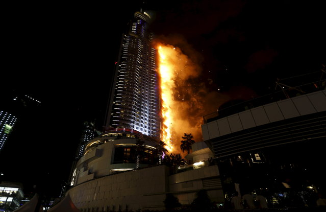 A fire engulfs The Address Hotel in downtown Dubai in the United Arab Emirates December 31, 2015. (Photo by Ahmed Jadallah/Reuters)