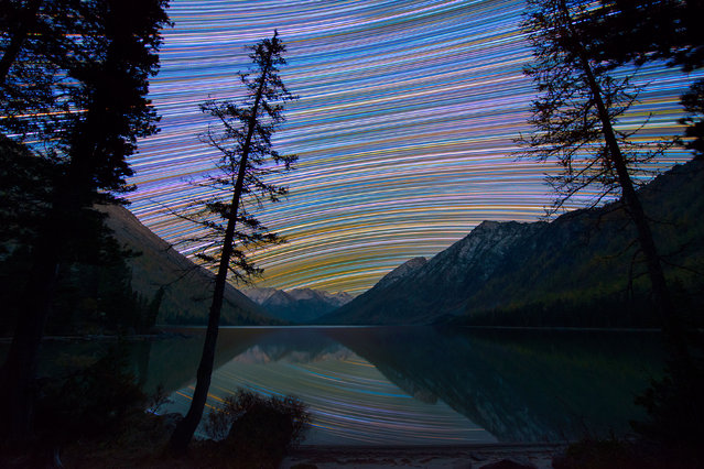 Vibrate, colorful star trails over a mountain range. (Photo by Evgeniy Zaytsev/Caters News)