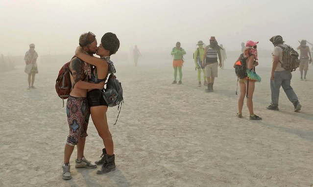 A couple kisses at Burning Man. (Photo by Andy Barron/The Reno Gazette-Journal)