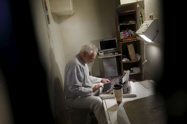 Charles Edwards Case, who is on death row for murder, types a letter to his attorney with a typewriter inside his cell on the East Block for condemned prisoners during a media tour of California's Death Row at San Quentin State Prison in San Quentin, California December 29, 2015. (Photo by Stephen Lam/Reuters)