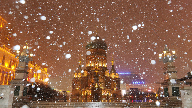 The Saint Sophia Cathedral is seen during a snowfall on April 12, 2021 in Harbin, Heilongjiang Province of China. (Photo by VCG/VCG via Getty Images)