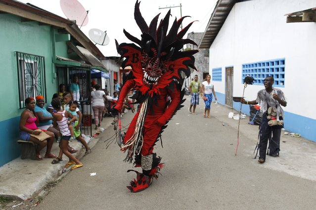 """A man, dressed up as the devil, performs during the """"Diablos y Congos"""" (Devils and the Africans) festival in Nombre de Dios, Colon Province, Panama February 18, 2015. The festival symbolises the historic struggle of African slaves against their Spanish masters. (Photo by Carlos Jasso/Reuters)"""