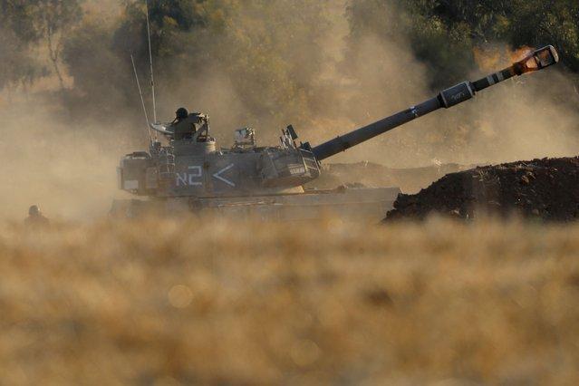 An Israeli artillery unit fires toward targets in Gaza Strip, at the Israeli Gaza border, Thursday, May 13, 2021. (Photo by Ariel Schalit/AP Photo)