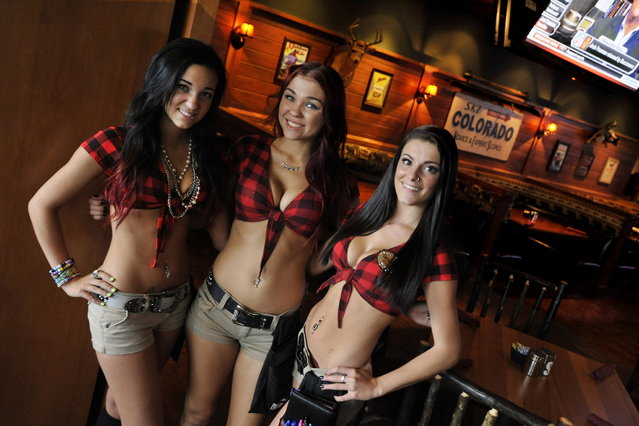 Servers at the Twin Peaks restaurant in Wheeling, Il.  Twin Peaks is one of the new wave of  that have been growing rapidly the last few years, in part at the expense of Hooters, which is still the biggest in the category, but has been struggling somewhat. Twin Peaks and rival Tilted Kilt dress their waitresses in even skimpier outfits than Hooters – short shorts, bare midriffs and big emphasis on cleavage. A restaurant-industry veteran recently bought the rights to open franchised Twin Peaks locations in the Milwaukee area and is currently scouting local real estate. (Photo by Paul Beaty/Journal Sentinel)