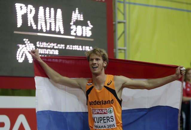Thijmen Kupers of Netherlands celebrates his third place at the men's 800 metres final during the European Indoor Championships in Prague March 8, 2015. REUTERS/David W Cerny (CZECH REPUBLIC  - Tags: SPORT ATHLETICS)