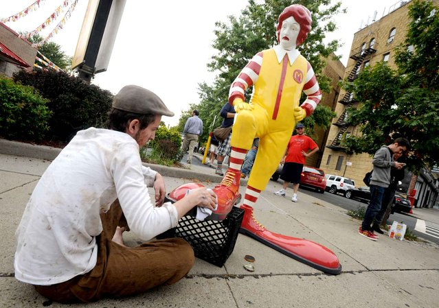 One of Banksy's latest pieces is this fiberglass sculpture of Ronald McDonald having his shoes shined in front of a McDonald's. (Photo by Dennis Van Tine/Newscom/SIPA Press)