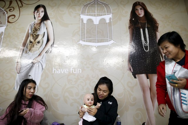 "A devotee dresses up her ""child angel"" doll inside a department store in Bangkok, Thailand, January 26, 2016. (Photo by Athit Perawongmetha/Reuters)"