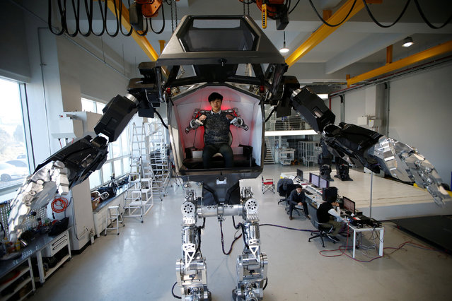 """An employee controls the arms of a manned biped walking robot """"METHOD-2"""" during a demonstration in Gunpo, South Korea, December 27, 2016. (Photo by Kim Hong-Ji/Reuters)"""