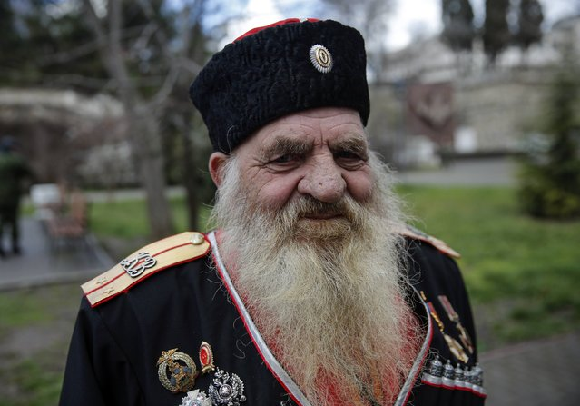 A Cossack looks on at a festive ceremony marking the first anniversary of the Crimean treaty signing in Sevastopol, March 18, 2015. (Photo by Maxim Shemetov/Reuters)