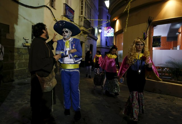 Revellers in fancy costumes are seen during the Carnival of Cadiz, southern Spain February 9, 2016. (Photo by Marcelo del Pozo/Reuters)