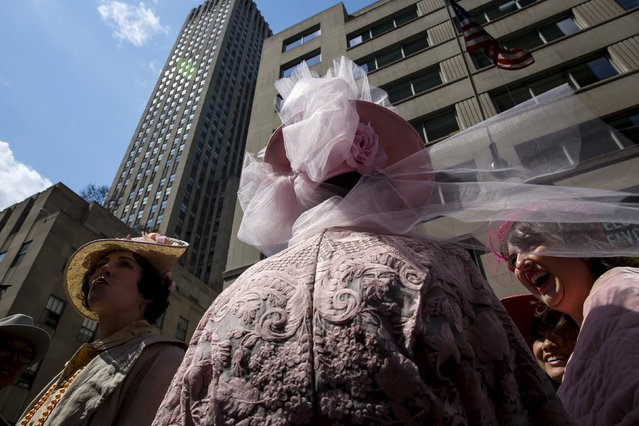 People take part in the Easter Parade and Bonnet Festival along 5th Avenue in New York City April 5, 2015. (Photo by Eric Thayer/Reuters)