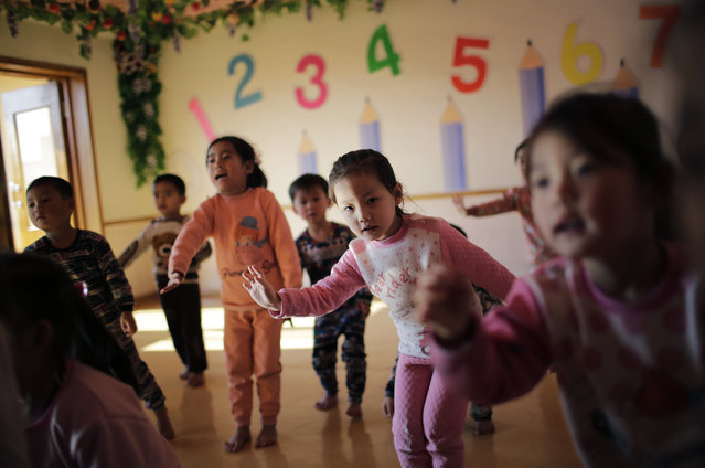 In this Friday, January 6, 2017, photo, children of workers sing and dance at a childcare center at the Kim Jong Suk Silk Mill in Pyongyang, North Korea. (Photo by Wong Maye-E/AP Photo)