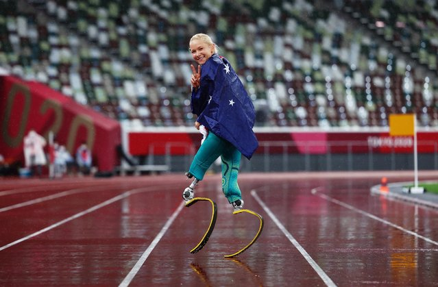 Vanessa Low of Team Australia celebrates after winning gold in the Women's Long Jump - T63 Final on day 9 of the Tokyo 2020 Paralympic Games at Olympic Stadium on September 02, 2021 in Tokyo, Japan. Low jumped 5.28m to set a new world record. (Photo by Athit Perawongmetha/Reuters)