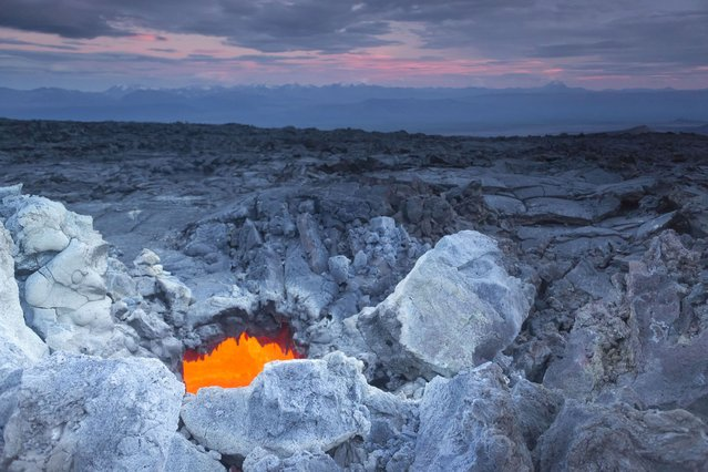 The underground entrance to the volcano resembles a scene from the latest Hobbit movie. (Photo by Denis Budkov/Caters News)