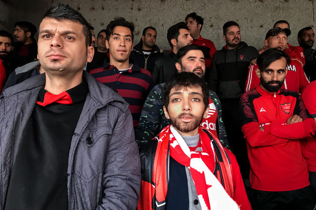 "Sports story nominee: Crying for freedom, by Forough Alaei. In Iran, female fans are controversially banned from entering football stadiums. On 20 June 2018 a ruling allowed Tehran's Azadi stadium to admit selected groups of women for international matches. A woman watches the AFC Cup match, disguised as a young man. The photographer, who also had to dress as a man, said: ""As a female photographer, I'm not permitted to take my camera to the stadium. Therefore, I had to pass myself of as a boy and use my iPhone to take this shot"". (Photo by Forough Alaei/World Press Photo 2019)"