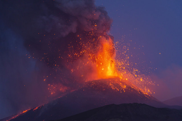 Smoke billows from the Mt Etna volcano as seen from Milo, Sicily, Monday, August 9, 2021. Europe's most active volcano remains active scattering ashes around a vastly populated area on its slopes. (Photo by Salvatore Allegra/AP Photo)