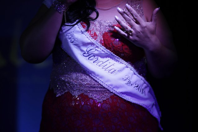 "Cintia Colina, talks on how the Miss Gordita 2014 title has turned her life around, gaining a newfound confidence, before passing on her title to the ""Miss Gordita 2015"" during the fourth edition of the beauty contest in Asuncion, Paraguay, Saturday, April 25, 2015. (Photo by Jorge Saenz/AP Photo)"