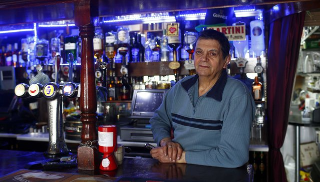 "Charlie Lambous, 51, poses for a photograph at his workplace, Charlie's Bar, in the London constituency of Brent Central, Britain, April 3, 2015.  Lambous, who was born in Cyprus, said: ""Last time I voted for the Conservatives but not this year. Maybe I'll vote for the Scottish one this year"". (Photo by Eddie Keogh/Reuters)"