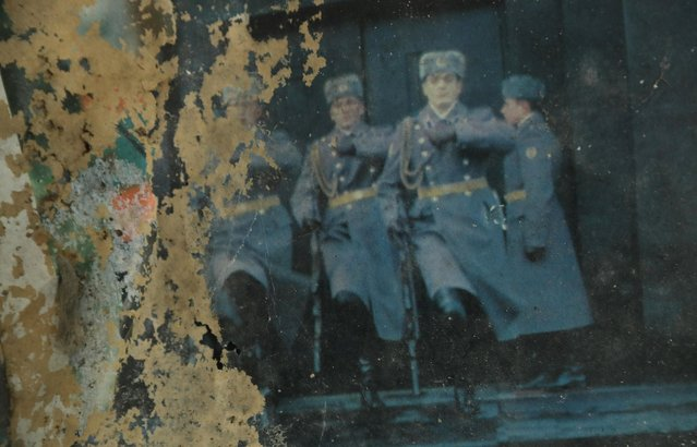 """Soviet troops are visible on an ageing Russian calendar on a wall in the officers' building at the former Soviet military base on January 26, 2017 in Wuensdorf, Germany. Wuensdorf, once called """"The Forbidden City"""", was the biggest base for the Soviet armed forces in communist East Germany from 1945 until the last Soviet troops left in the early 1990s following the end of the Cold War and the reunification of Germany. While Soviet troops pulled out of eastern Europe after 1989, Russian troops have in recent years intervened in Ukraine. The NATO military alliance has strengthened its presence in the Baltic states in an effort to prevent similar Russian intervention there. (Photo by Sean Gallup/Getty Images)"""