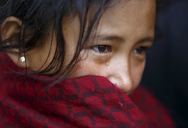 Bimala Lopchan Tamang, 15, cries upon learning the death of her husband Udas Tamang, 16, whose body was recovered from collapsed building by rescue workers on the fifth day after the earthquake hit Nepal in Kathmandu, Nepal April 29, 2015. Udas had arrived in Kathmandu from Nuwakot to go overseas to earn money and have better futures with Bimala, whom he married last year. (Photo by Navesh Chitrakar/Reuters)