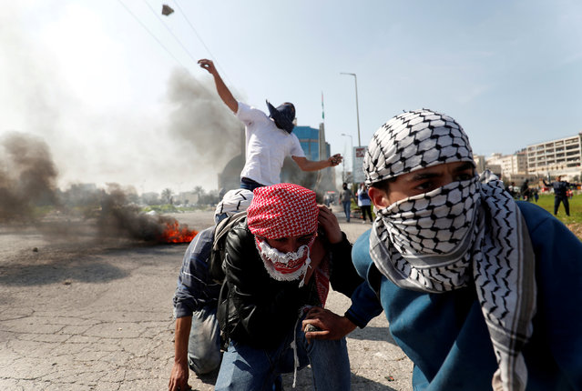 Palestinian protesters hurl stones at Israeli troops during clashes near the Jewish settlement of Beit El, in the Israeli-occupied West Bank March 20, 2019. (Photo by Mohamad Torokman/Reuters)