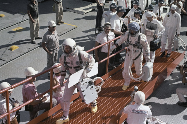 Astronauts James A. Lovell Jr and Edwin E. Aldrin Jr in space suits walking towards the launch pad, shown in an undated photo. (Photo by AP Photo)