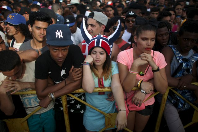 People gather to watch a performance by U.S. electronic music group Major Lazer in Havana, March 6, 2016. (Photo by Alexandre Meneghini/Reuters)