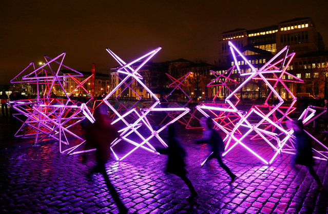 Children run past an artistic light installation in the Brussels' canal district during the Bright Brussels Festival in Brussels, Belgium February 4, 2017. (Photo by Francois Lenoir/Reuters)