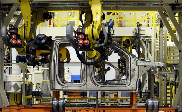 Robotic arms rivet together the cab of a Ford F150 pickup at the Kansas City Assembly Plant where new aluminum intensive Ford F-Series pickups are built in Claycomo, Missouri May 5, 2015. (Photo by Dave Kaup/Reuters)