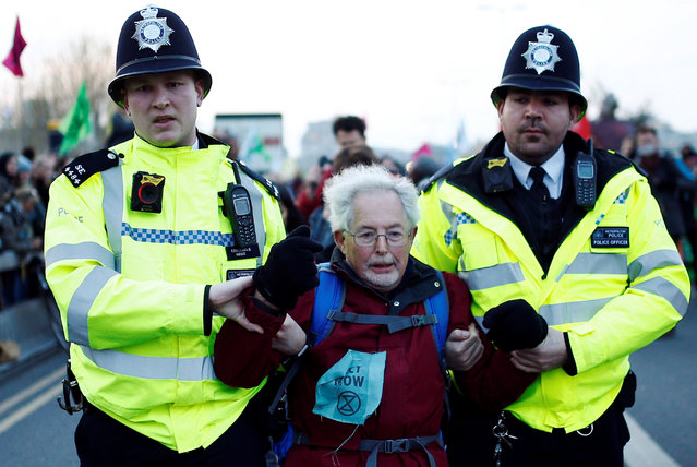 Police detain a protester as climate change activists demonstrate during a Extinction Rebellion protest at the Waterloo Bridge in London, Britain on April 15, 2019. (Photo by Henry Nicholls/Reuters)