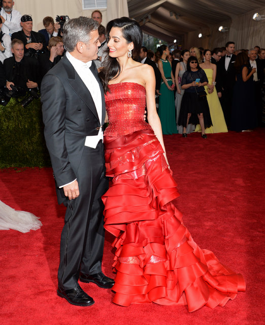 """George Clooney and Amal Clooney arrive at The Metropolitan Museum of Art's Costume Institute benefit gala celebrating """"China: Through the Looking Glass"""" on Monday, May 4, 2015, in New York. (Photo by Evan Agostini/Invision/AP Photo)"""