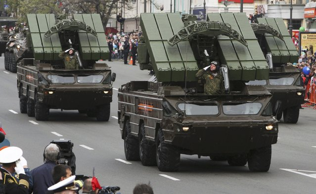 Servicemen drive Osa short-range tactical surface-to-air missile systems during the Victory Day parade in Vladivostok, Russia, May 9, 2015. (Photo by Reuters/Host Photo Agency/RIA Novosti)
