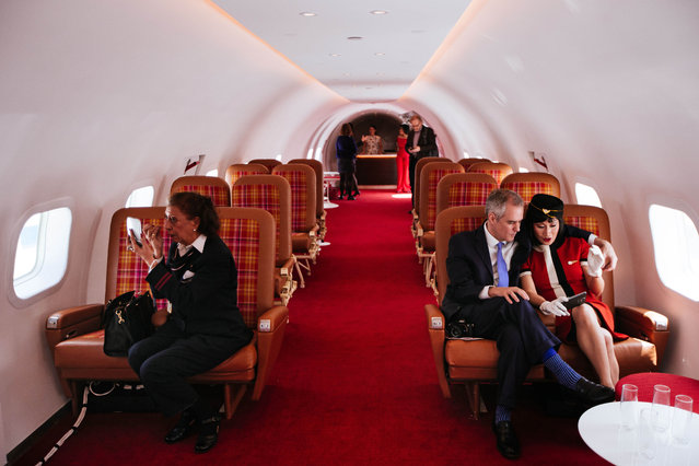 """Visitors sit in the cabin of """"Connie"""", the 1958 Lockheed Constellation airplane restored as a cocktail lounge at the newly opened TWA Hotel at JFK Airport on May 15, 2019 in New York City. The new, 1960's themed hotel built inside the former Trans World Airlines terminal includes high end retail shops, restaurants, and a rooftop bar with runway views. (Photo by Kevin Hagen/Getty Images)"""