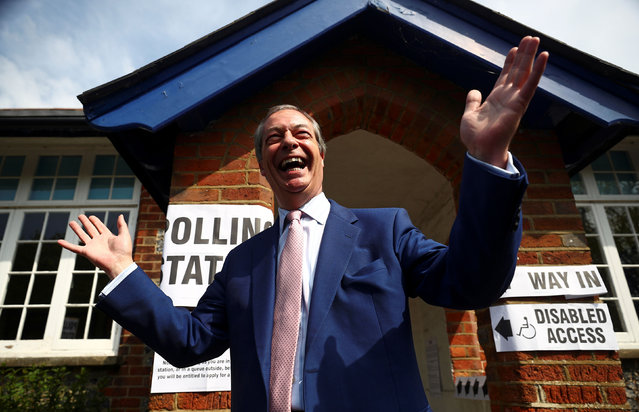 Brexit Party leader Nigel Farage gestures as he leaves a polling station after voting in the European elections, in Biggin Hill, Britain, May 23, 2019. (Photo by Hannah McKay/Reuters)