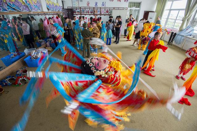 Children rehearse a dance performance in Hai'an, Jiangsu province, China on May 30, 2019. (Photo by Costfoto/Barcroft Media)