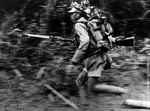 1942: A Chinese soldier in camouflage runs towards a new position somewhere in Burma