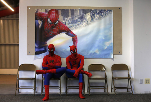 """Peter Norbot and Kris Hamilton wait to audition for a promotional campaign for """"The Amazing Spider-Man 2″ in Chicago, on March 19, 2014. (Photo by Jim Young/Reuters)"""