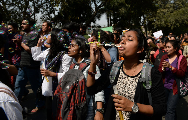 An Indian student blows bubbles as she joins others during a protest march outside Delhi University against the Akhil Bharatiya Vidyarthi Parishad (ABVP) students wing of Bharatiya Janata Party (BJP) in New Delhi on February 28, 2017, after it was accused of attacking students, lecturers and journalists in the campus on February 22. (Photo by Sajjad Hussain/AFP Photo)