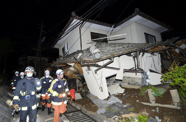 Firefighters check a collapsed house after an earthquake in Mashiki town, Kumamoto prefecture, southern Japan, in this photo taken by Kyodo April 15, 2016. (Photo by Reuters/Kyodo News)
