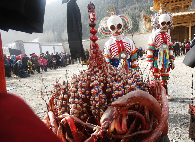 Lamas guard the religious weapons as others present skull dance
