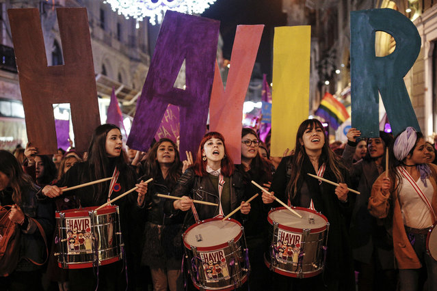 "Women holding letters forming the word ""NO"" in Turkish, play drums and chant slogans during a protest marking the International Women's Day, in central Istanbul's Istiklal Avenue, the main shopping road of Istanbul, Wednesday, March 8, 2017. (Photo by Emrah Gurel/AP Photo)"