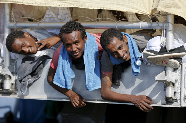 Migrants wait to disembark from the expedition vessel Phoenix in the Sicilian harbour of Augusta, Italy June 17, 2015. REUTERS/Antonio Parrinello