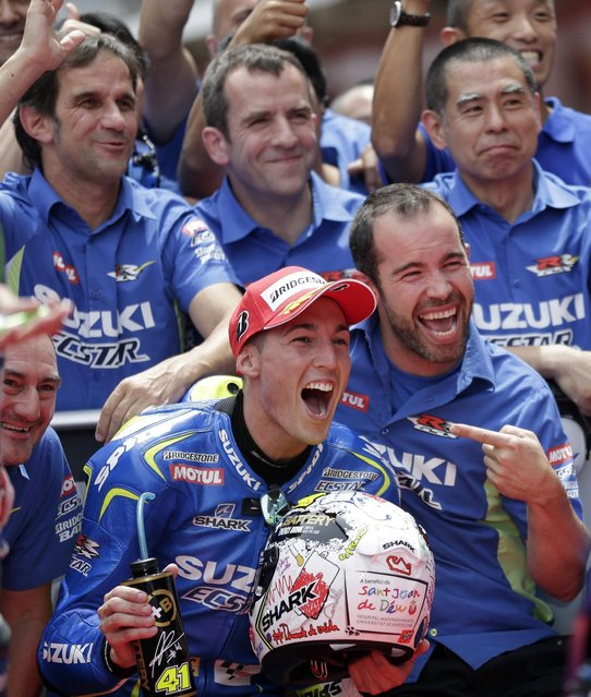 Aleix Espargaro of Spain and Team Suzuki MotoGP reacts after clocking the fastest time to take pole position for Sunday's Spanish Motorcycling in Montmelo, Spain, Saturday, June 13, 2015.  The Catalunya Grand Prix will take place on Sunday in Montmelo. (AP Photo/Manu Fernandez)