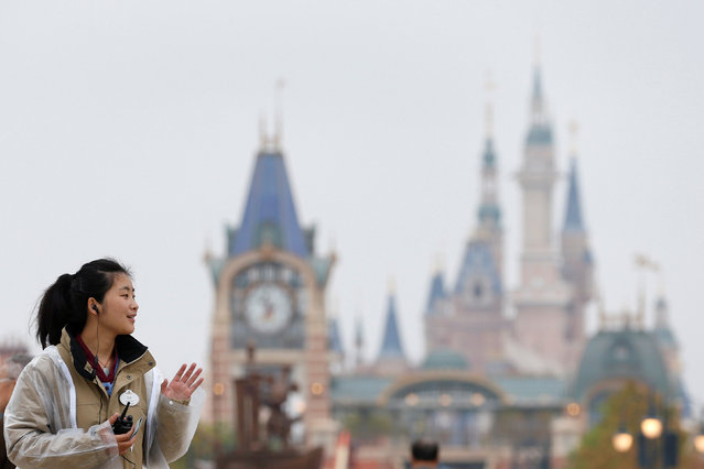 A member of staff waves as she welcomes people coming to Disney Town of Shanghai Disney Resort in Shanghai, China, April 26, 2016. Shanghai Disney Resort will officially open on June 16. (Photo by Aly Song/Reuters)