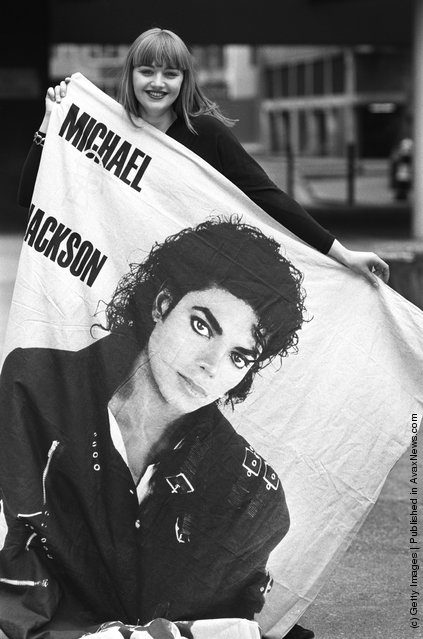 A Michael Jackson fan with a large poster of her idol on April 14, 1988