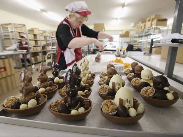 Employee Doreen Krohe packs chocolate Easter bunnies and eggs at the production facility at Confiserie Felicitas chocolates maker in Hornow. Easter is among the busiest times of year for the chocolatier, which produces Easter bunnies and eggs in a wide variety of sizes and styles. (Photo by Sean Gallup/Getty Images)